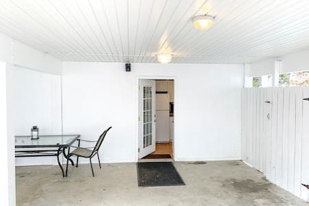 Ground floor apartment (king bed, full kitchen, full bath with steam room) has no stairs to entrance or throughout. Located immediately off of covered driveway.