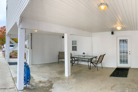 Large, wide driveway, with parking area on covered patio, directly outside of accessible ground floor apartment.