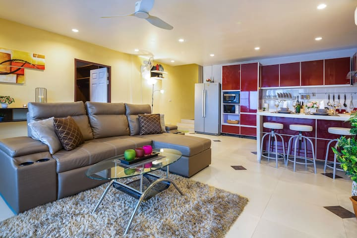 The large living room with modern open kitchen