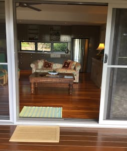 Double size door opening from deck into living space. Opening only has low sliding door threshold.