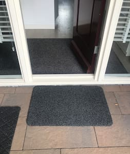 Entrance door, small step to get indoors.