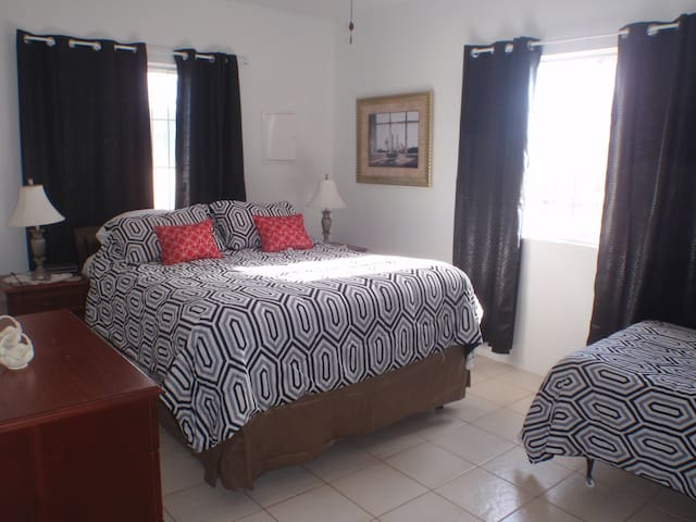 2nd bedroom also with a twin bed.  Darkening drapes to sleep late.  Very comfy bed