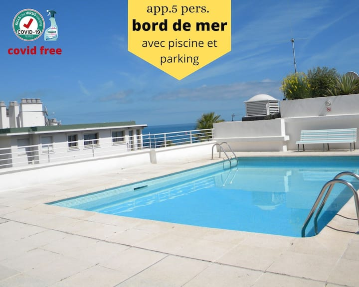 beach front ap.(2-5p.) with pool and parking