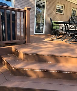 3 well-lit steps to deck and back door