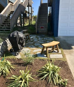 The flagstone patio/path is lit by dusk to dawn spotlights that are motion activated. There is a light next to the door at the top of the stairs that is always left on.