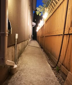 The path to the apartment at night.