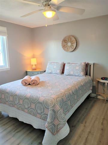 2021 Queen bedroom: new flooring and a fresh coat of paint.