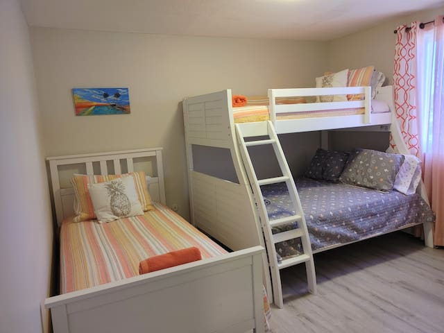 2021 Bunk bedroom. New twin over full bunk bed and additional twin. New floors and fresh paint!