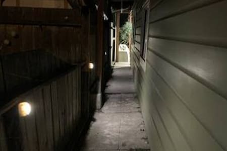 The driveway is well lit by a light sensing streetlight. There are motion sensing path lights along the walkway from the driveway gate to the entrance, and a motion sensing overhead light above the entrance.