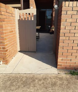 No step access and a gentle slope up to the apartment  door.