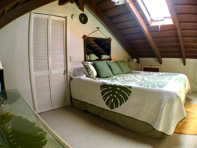 Loft Bedroom with comfortable King Size bed, ceiling fan and skylight providing light and ventilation!