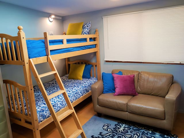 The Bunk Room is a fun hangout for kids and young adults, with individual phone charging stations, high-tech adjustable brightness reading lamps, a couch and TV.