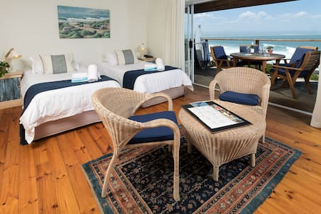 The bedroom of the Flat is upstairs, with a beauticul view of sunrise and the dolphins swimming past.  The bedroom can be set-up with two single beds or a kign size bed.