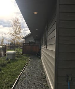 4 foot wide (plus) lighted gravel pathway from 2-car deep lighted carport