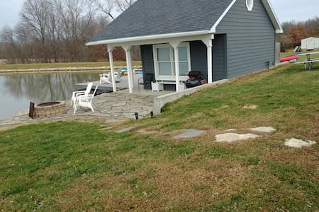 From the driveway, gentle slope to patio/deck. Porch lights and landscape lights to entry.  No stairs.