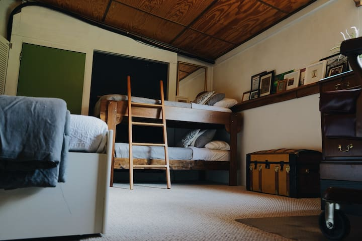 The second bedroom boasts another king sized bed and a set of bunk beds, as well as a desk.