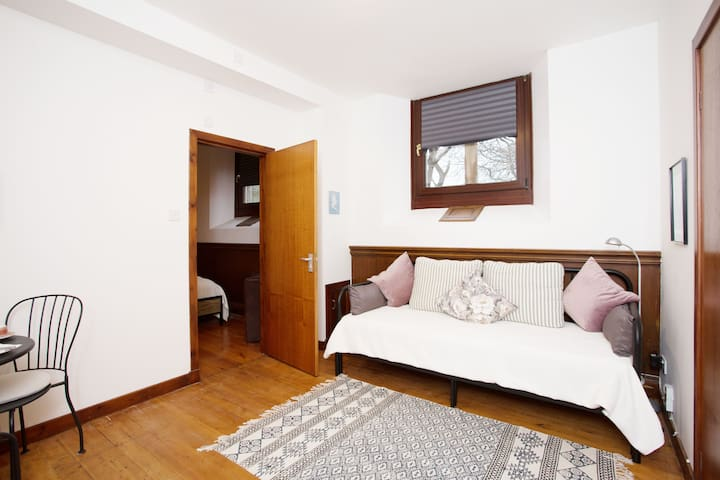 ...adjacent room either as your private lounge/breakfast room or with the double day bed for kids or friends.