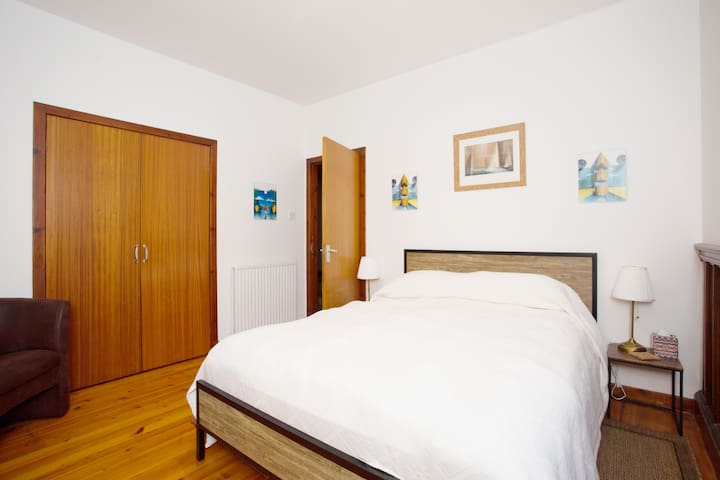 Suite 3 with door to private bathroom and large built-in wardrobe