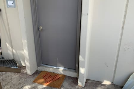 """The front door is 34"""" wide. There is a 4.5"""" half step on the door threshold."""