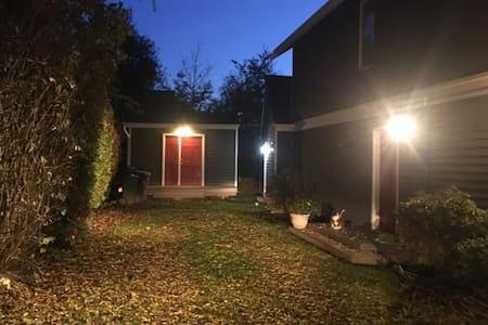 Park in driveway, well lit at night