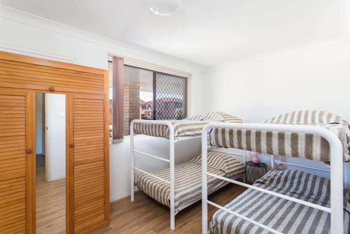 Double bunk beds, with comfortable mattresses and pillows, make for great family sleeping arrangements
