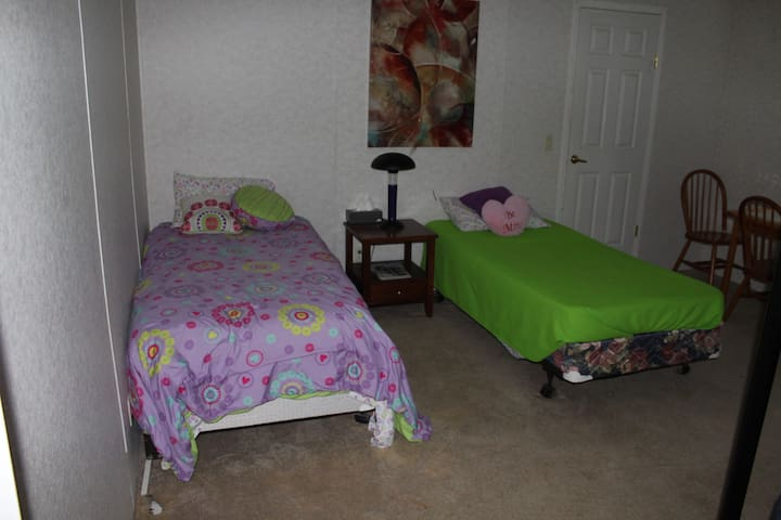 Kids room with full size beds.