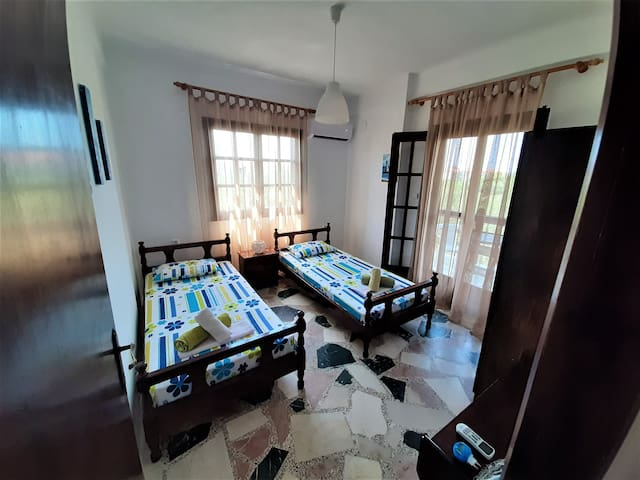 Entering the 2nd sunshine bedroom (both 2 bedrooms are decorated with handmade paintings & constructions).