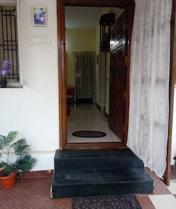 Main entrance to house, two steps to enter the house and a flat path henceforth throughout the home. Space between the door frame is 33 inches.