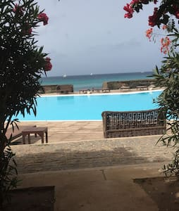Gentle ramp to level terraced area in front of entrance sliding full size patio door. Stunning sea views from terrace and level access to pool