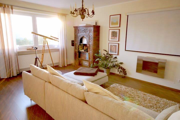 Spacious living room with fully-equipped home theatre and Airplay features