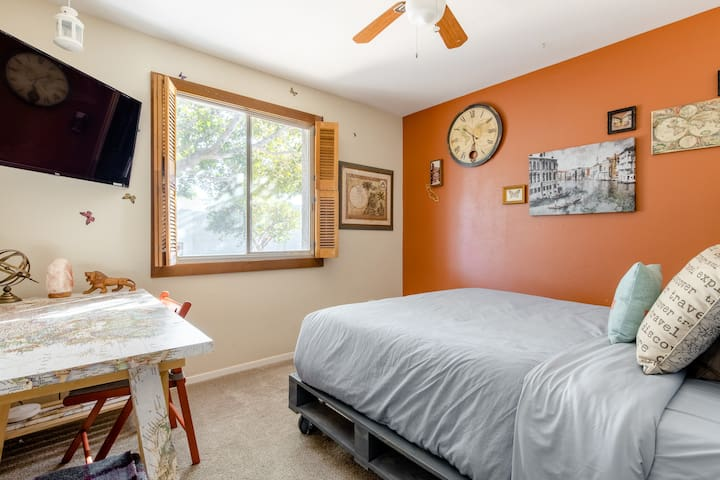 second bedroom, travel themed, queen size bed, handmade bed frame and headboard, custom work map desk, ceiling fan