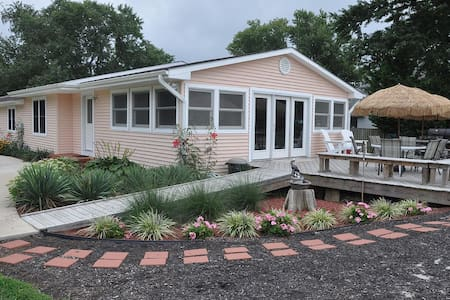 Our ramp into the kitchen, dining, living, bedroom, and bath areas has a slight slope as you enter off the concrete parking pad in the front of the Kent Island Beach House. The entry at the garage has no steps as well into the very large family room