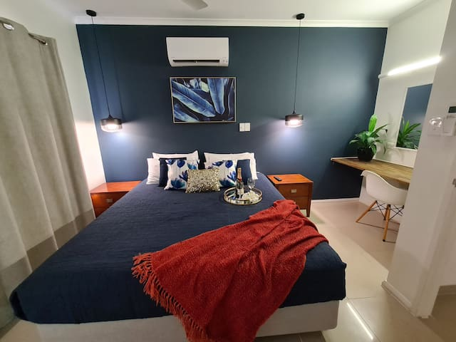 first floor - Master Bedroom with king size bed, airconditioning, TV, work space, walk in robe and ensuite.