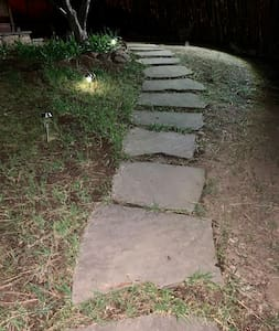 Flagstone path to the casita has solar path lights and two motion lights to illuminate the way.