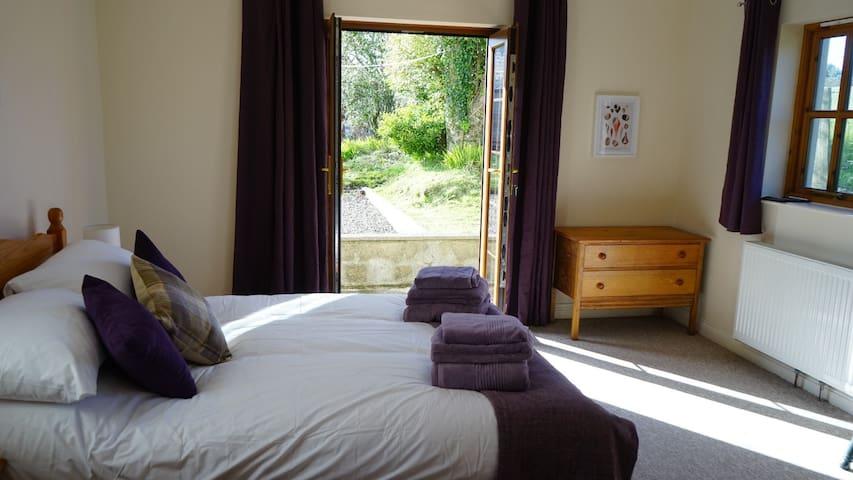 The ground-floor double bedroom has French doors that lead into the garden
