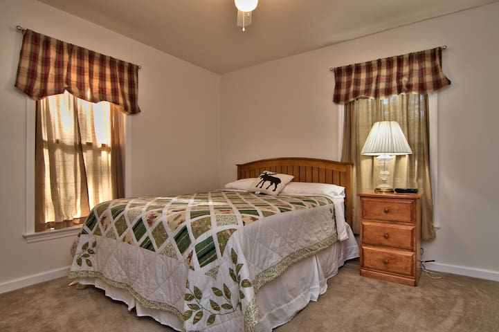 Main Level Country Bedroom is light and airy