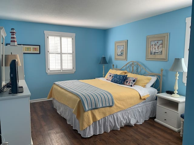Master bedroom with king size bed, flat screen TV and DVD player