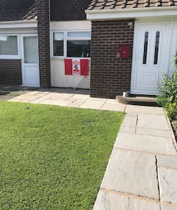 Level pathway, small step up to front door of flat access via side door ( please ignore football flag curtesy of my son ! ) Automatic security lighting at Night above front door
