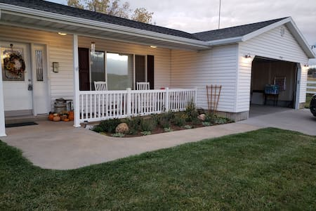 """Wide sidewalk and entrance to front door.All one level. Front door has 4"""" service step."""