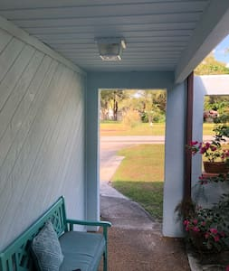 The driveway surface is flat. The only time you step up is to enter the house. It is a 3 inch rise.