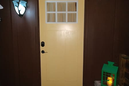 """36"""" front door (pictured) and 60"""" outswinging French doors (not pictured), both on same level as deck."""