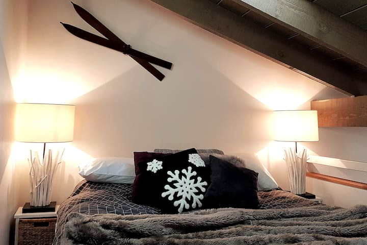 Plush queen pillowtop bed in the loft bedroom with a skylight to watch the weather!