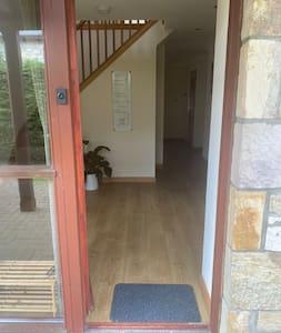 Front door entrance into hall