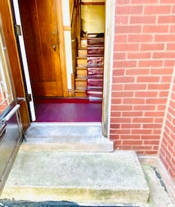 Our building main door is wide but has steps in the entrance.