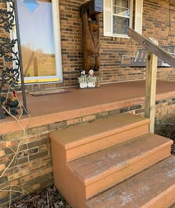A solid railing to help going up or down.