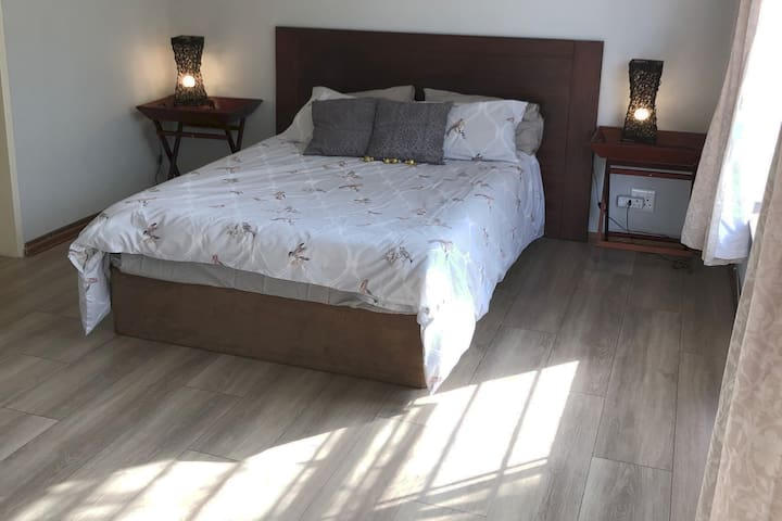 Master bedroom with newly upgraded laminate flooring.