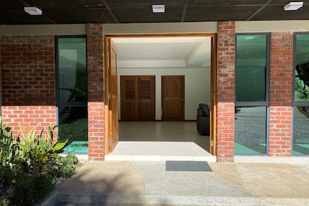 Flat entrance to the main door of the Lodge.