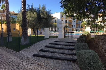 This is not the path to the apartment but to the pool. I include it as I don't yet have one for the apartment but hope to rectify this soon and it shows how the condo provide sloped access as well as steps.
