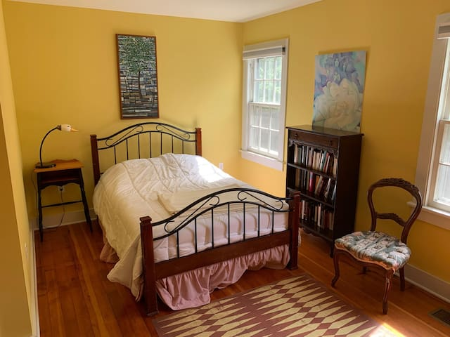 """The """"C"""" or Yellow Bedroom with a Double Bed."""
