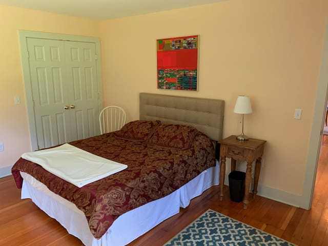 """Bedroom """"A"""" is Peach Room near the kitchen and second bathroom."""